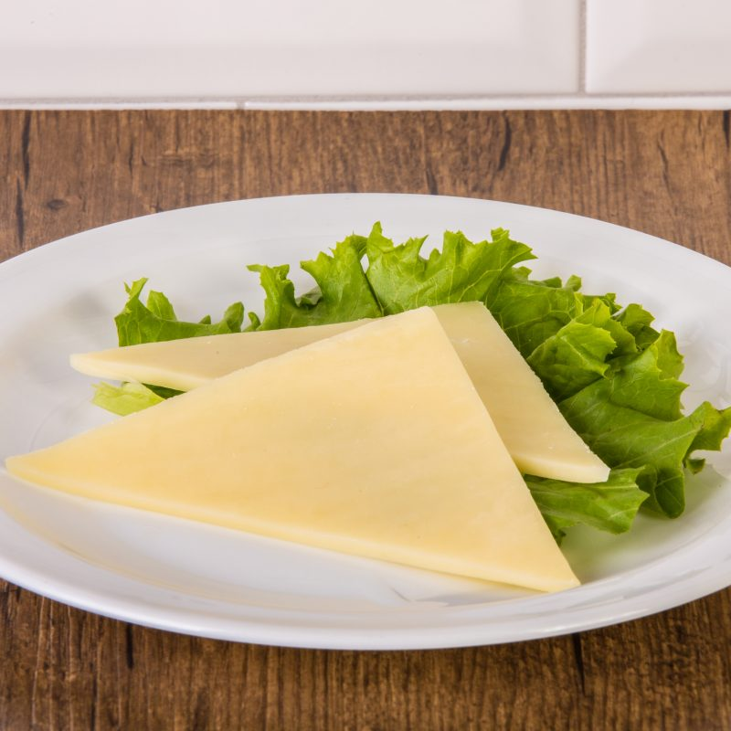 Fromage cheddar ou suisse (1 tranche)